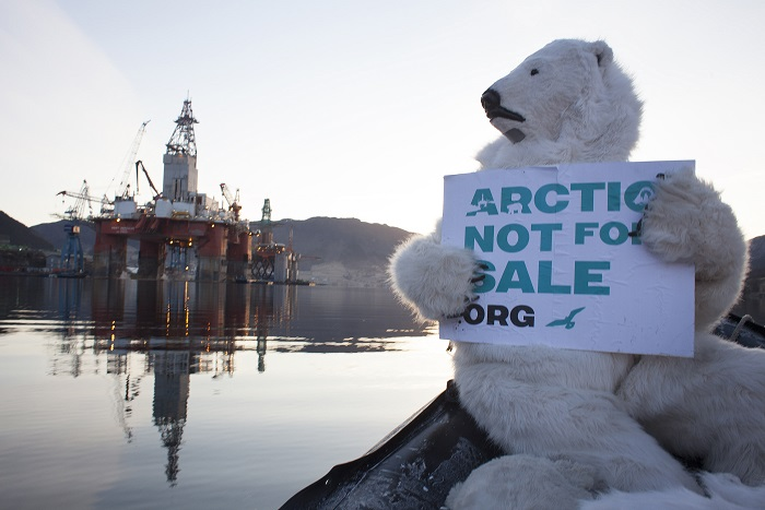 10 APR 2013 : Two Greenpeace activists dressed as polar bears climb the oil drilling rig West Hercules at an upgrading facility in Ølen, Rogaland in Western Norway. The curious polar bears began inspecting the rig which is due to leave shortly for the Arctic as part of Statoil's extensive summer drilling program in the northern reaches of the Barents Sea.  Nick Cobbing/Greenpeace